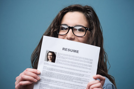 Young woman holding a resume